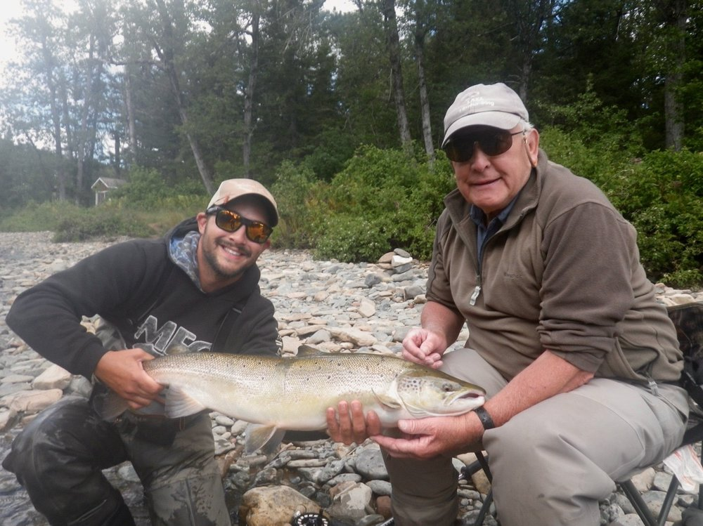 Peter Fraser (right) and our new Salmon Lodge guide Alex Mallais put one back on the Grand Cascapedia, Well done Peter!