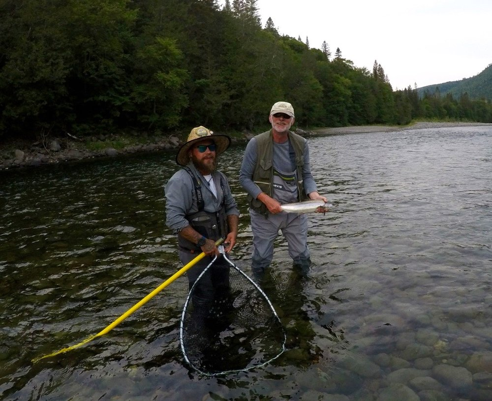 David Richens (right) with a nice Grand Cascpedia grilse. The water was low but David certainly did a fine job.