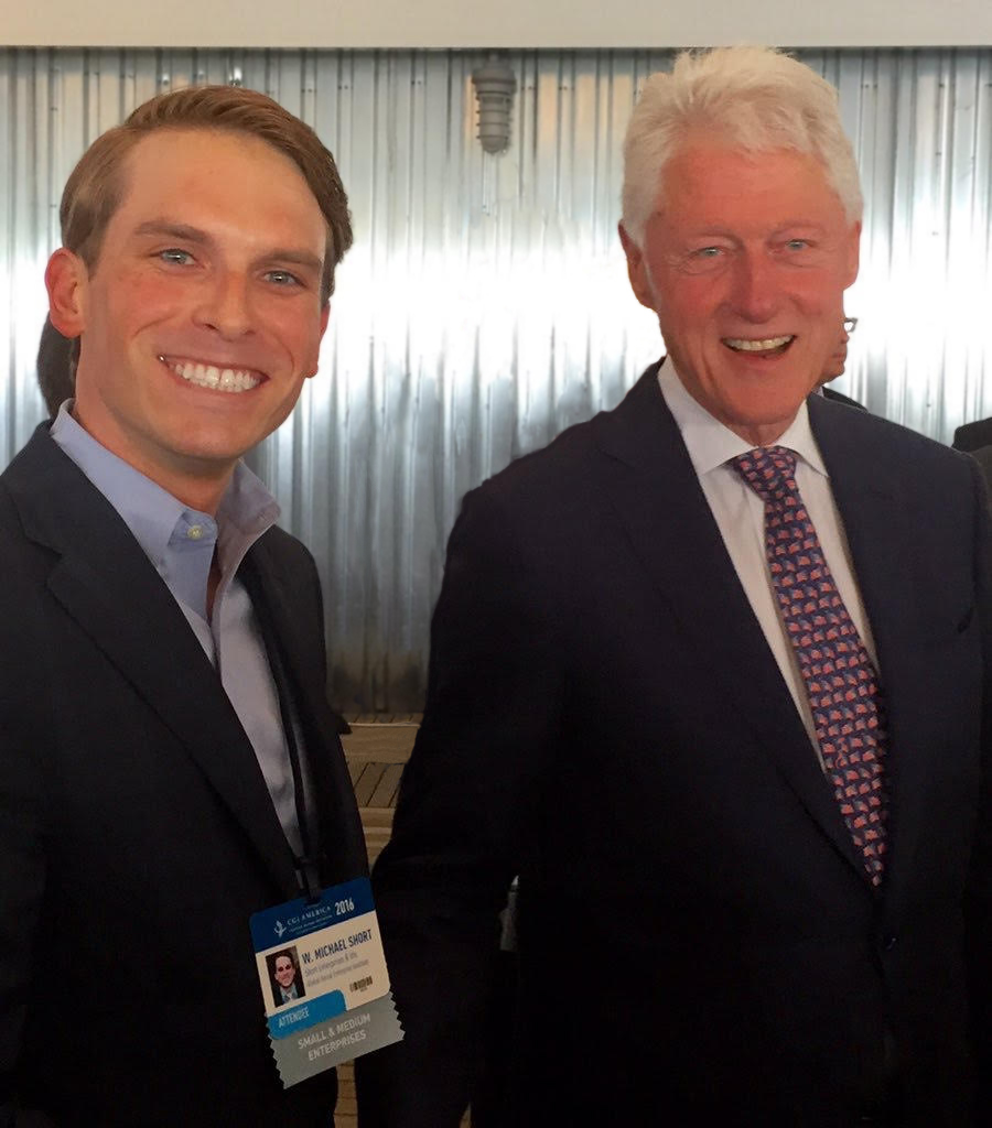 Pictured: W. Michael Short, founder of SourceFunding.org, with President Clinton.
