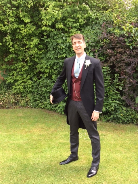 Oliver Phelps (Harry Potter actor), dressed in his traditional bespoke morning suit.