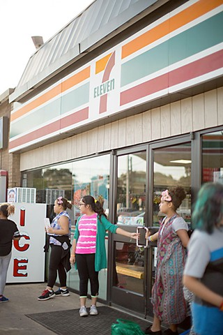 Students line up outside a 7-Eleven to promote healthy eating.  Austin Chronicle - December 23, 2016
