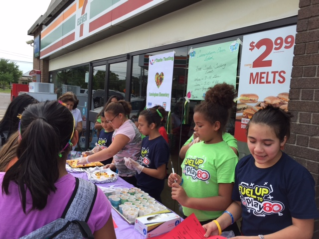 Providing healthy food samples outside of our Healthy Corner Store Initiative partner,7-Eleven