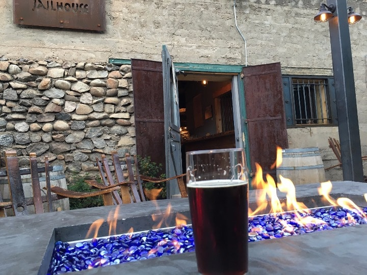 Enjoying a beer by one of the fire pits on the patio - the historic Buena vista jailhouse