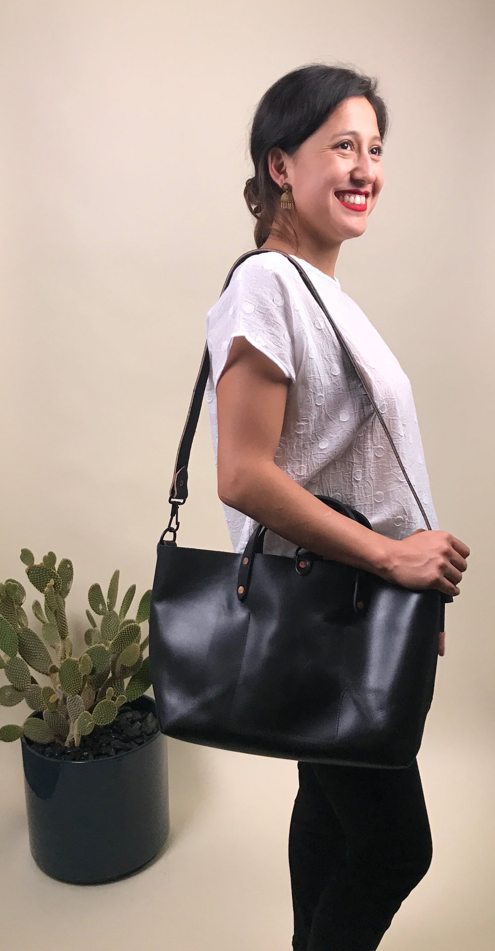 swiss dot shirt + leather tote