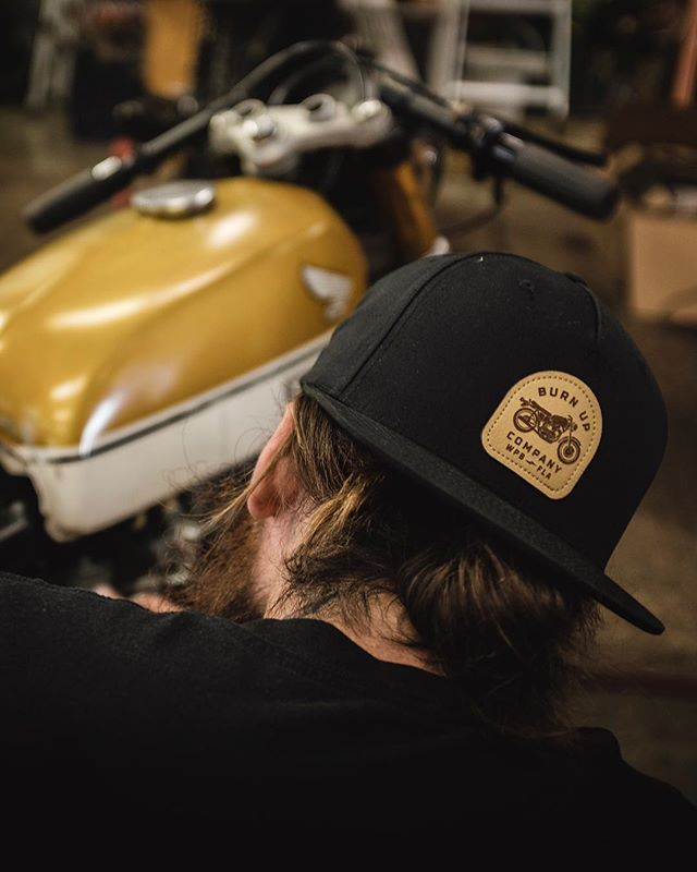 ⚡️NEW ARRIVAL ⚡️ . The Burn Up Company snapback with faux-leather embossed badge! Available at both locations or online — www.burnupcompany.com . The fully custom CB350 Hardtail Racer is available. Full photos and info are on our site. Link in bio.