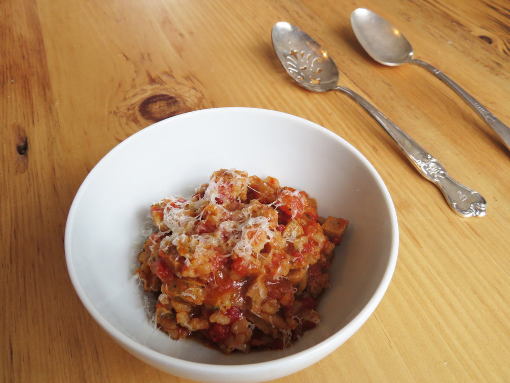 ½ c brown rice, cooked       1 Chicken Sausage, small dice (I used Al Fresco Chicken Sausage- Sweet Italian)       ½ c chopped tomatoes (fresh or canned)       1 tsp Italian seasonings       ¼ c water       1 bay leave       S/P       1.) Heat medium saute pan over medium - heat, when hot add a touch of cooking oil and add diced Chicken Sausage. ( I use EVOO or Coconut Oil that comes from a spray bottle)    2.) Once the sausage gets slightly browned add, rice tomatoes, water, seasoning, bay leaf and bring to a boil, and then let simmer and stir occasionally.    3.) Let mixture simmer softly until most of the liquid has evaporated. Season with salt and pepper to taste.    4.) Top with a little grated parmesan and/or fresh herbs.    Serve hot!    I always try to have cooked brown rice in my fridge along with some things that are easy to heat up quickly. Pre chopping ingredients is always a good idea if you know you will use them within a couple days.     I also suggest grating your cheeses on a microplane or citrus zester. This will allow for the cheese be sliced thinner giving it a much lighter fluffier texture, and be more easily distributed over the dish. This technique is also good for when you are grating cheese over salads.     Variations:    Throw an over easy egg on top and make breakfast!    Add chopped broccoli or leafy greens for some more fiber and nutrients.