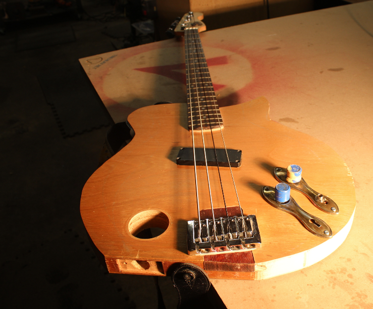 A bass made out of a hollow core door.