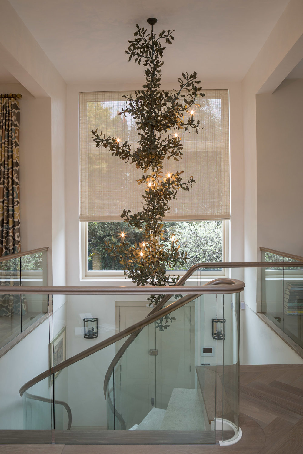This stunning chandelier creates a wonderful centrepiece which can be seen when entering and from the whole of the first floor.  Controlled by the  Lutron  Lighting system it can be dimmed to the perfect lighting setting for any time of day