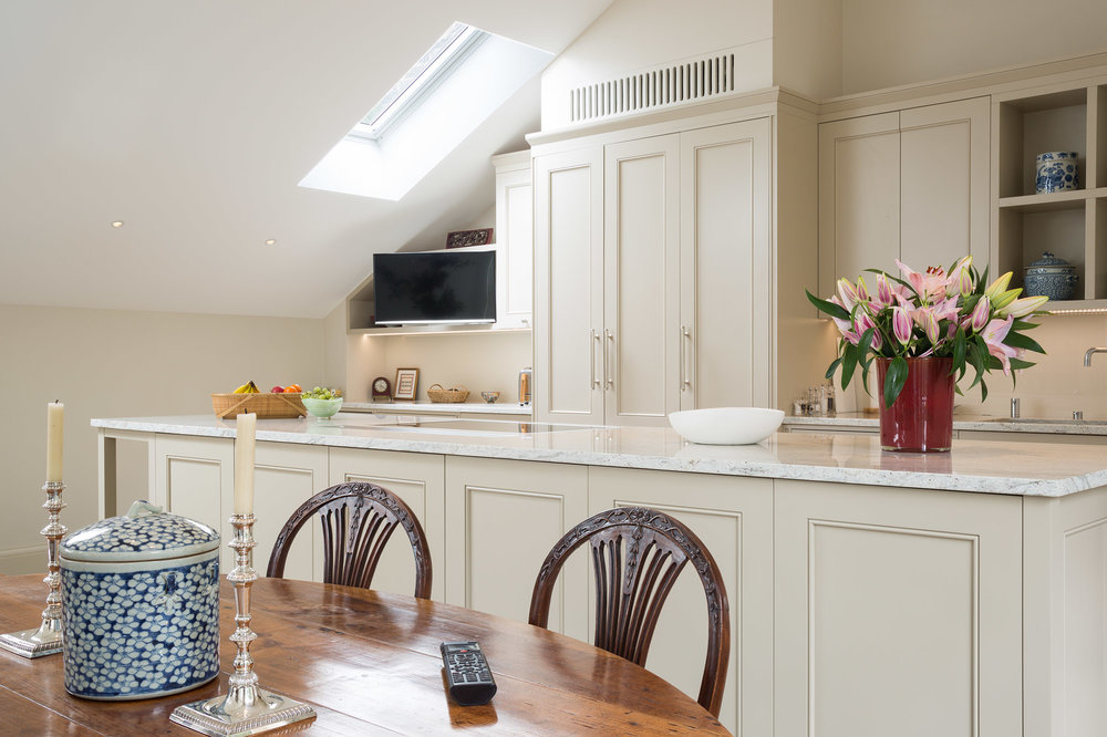 The Kitchen and Dining areas can view the TV which is mounted on a pull-out and swivel bracket.  The TV and In-ceiling Speakers can be controlled from the  Control4  handheld remote, or iPad/iPhone app.