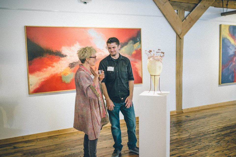 Weaver (left) joined by fellow exhibiting artist Cody McLouth (right) to discuss her new work..