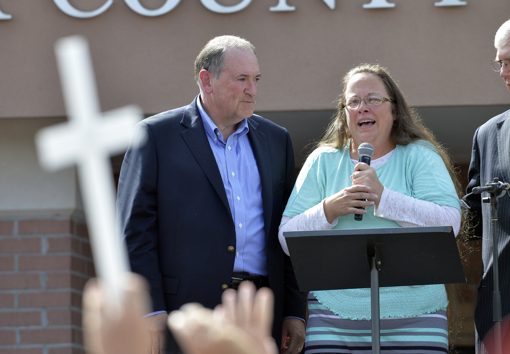 Kentucky Clerk Kim Davis, with Republican presidential candidate Mike Huckabee at her side, greets a crowd of supporters after being released from jail on Sept. 8. (Photo: AP)