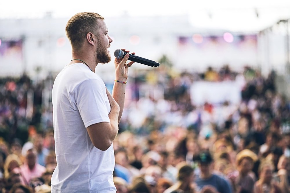 Dan Reynolds addresses the crowd gathered to attend the LoveLoud Festival in a scene from the new HBO documentary,  Believer.  / Photo courtesy of HBO.