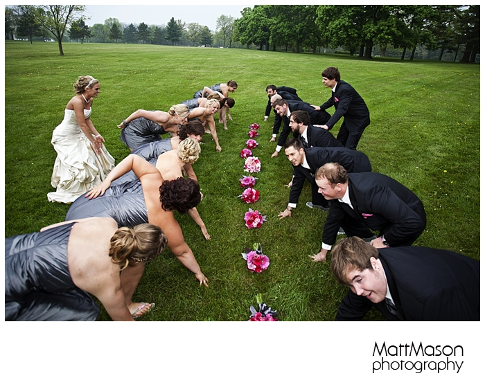 Bridesmaids against groomsmen football stance