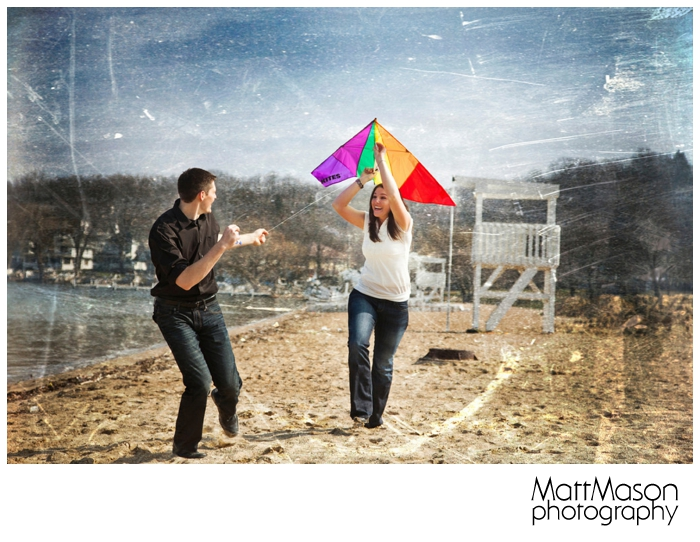 Couple flying kite on engagement session