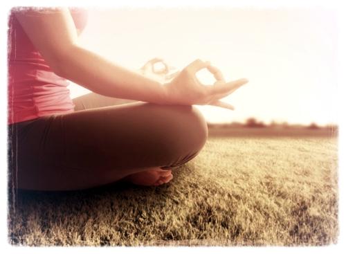 woman meditating in a yoga pose.jpg