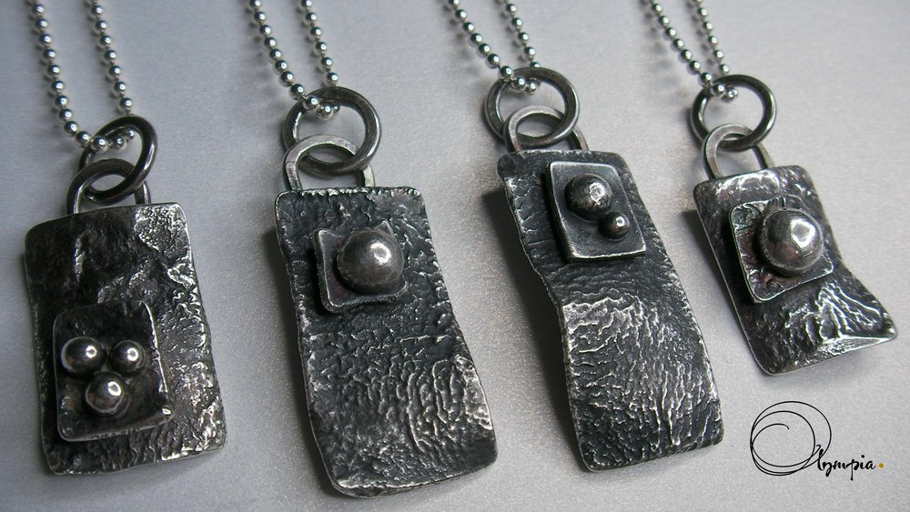line up of reticulated pendants.jpg