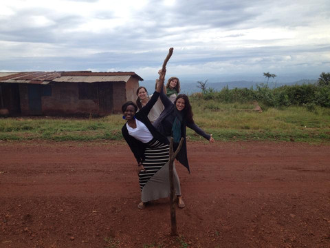 Dorothy, Dyan, Jill, and Ali at the Rwanda-Tanzania border