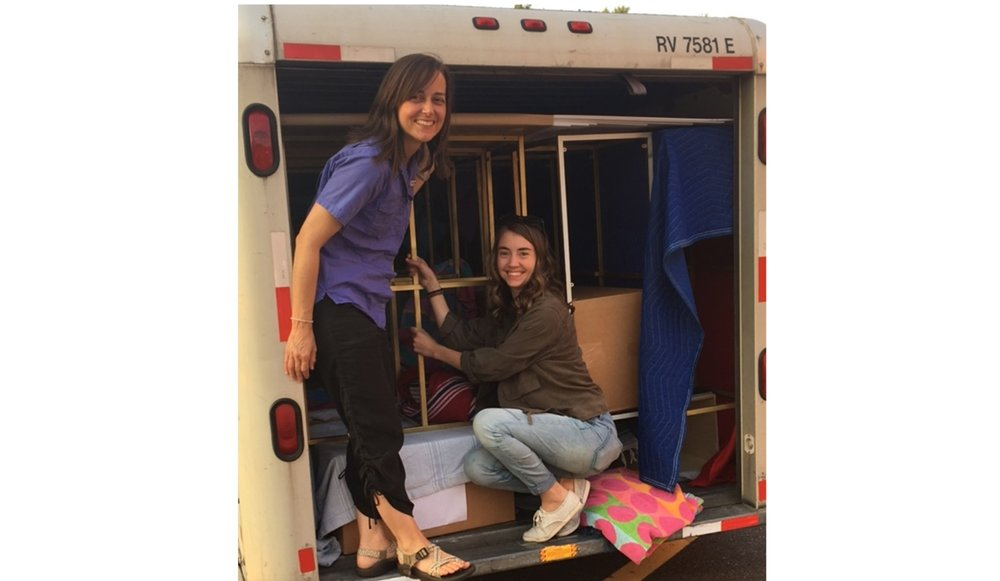 One of our fearless leaders, Jill Morley, engineering our packing with team member Raychel.