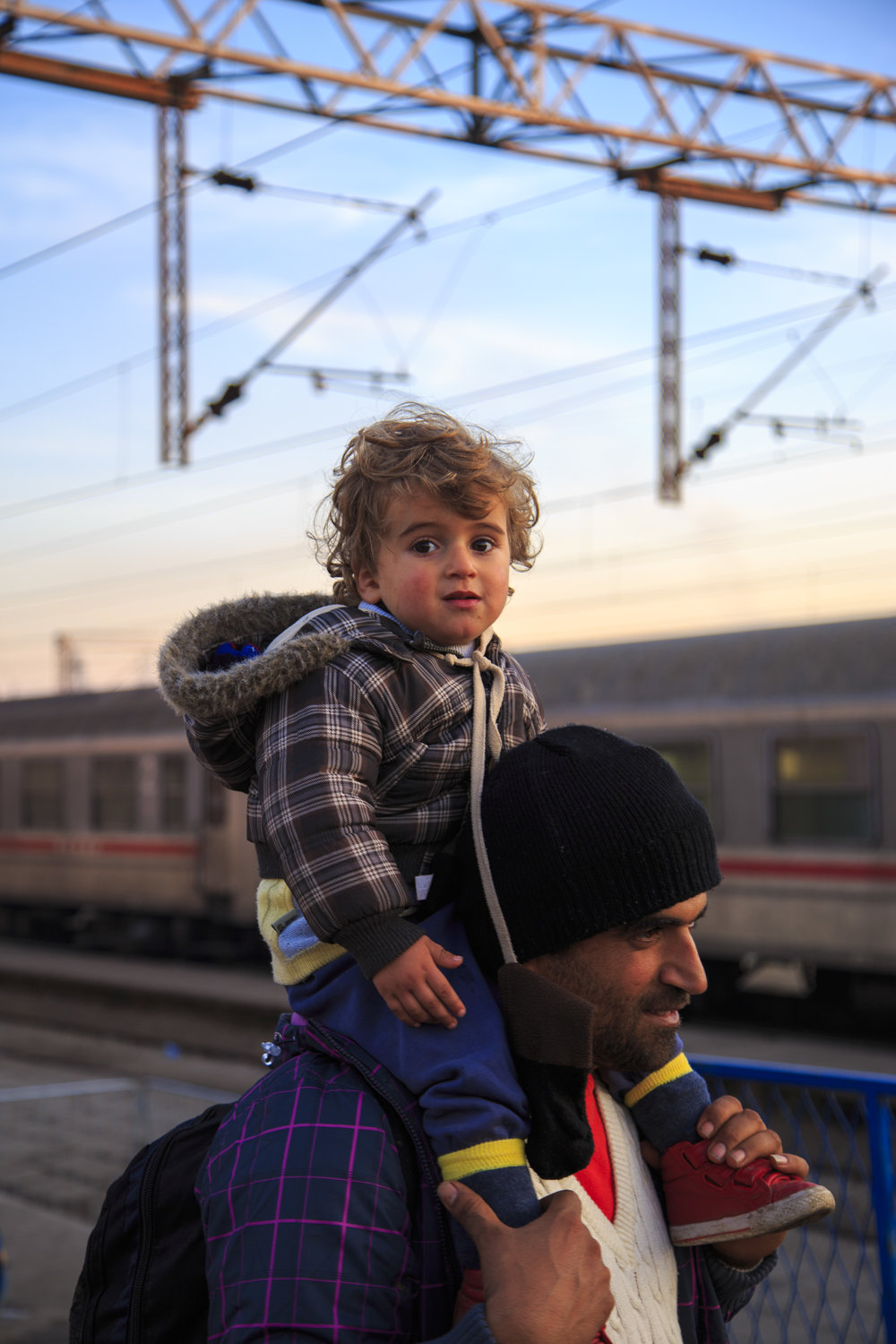 A Father and Son lineup to cross the border into Croatia on their quest for safety and a new life during the height of the Syrian refugee crisis.