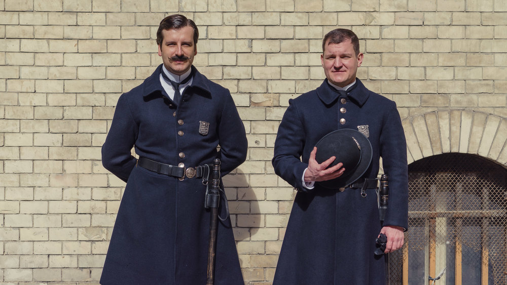extras in Budapest Hungary become fast friends pretending to be New York cops during the mid 1890's on set of The Alienist
