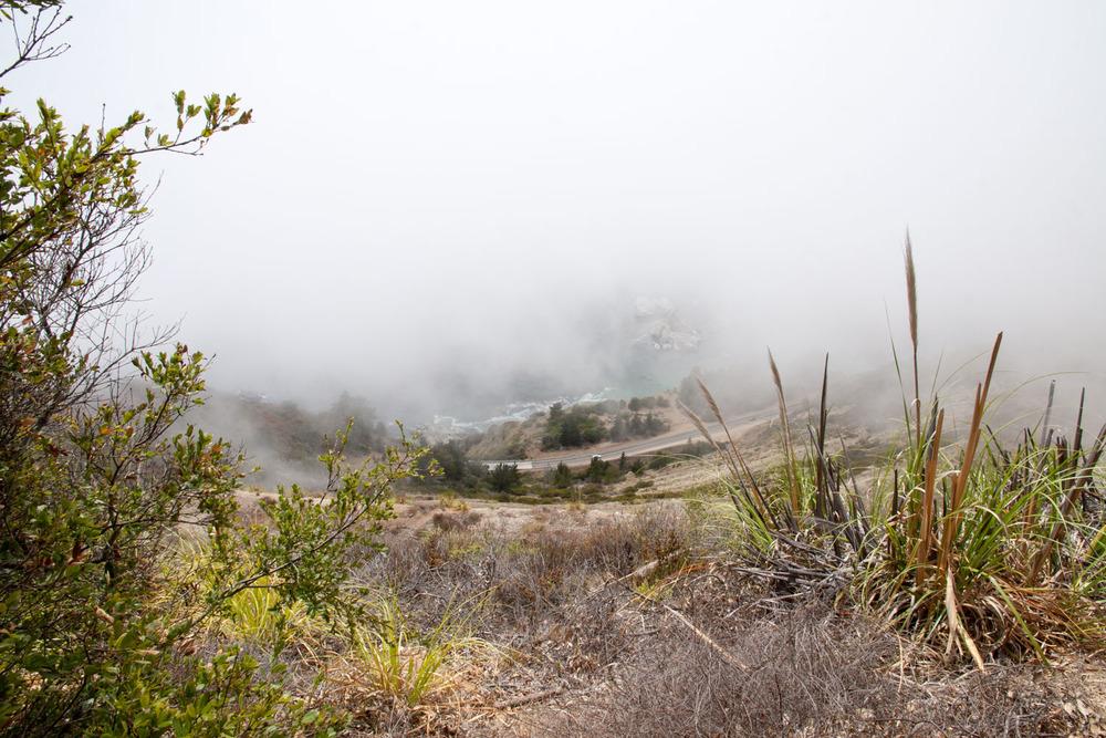 fog breaking away to reveal part of the road below
