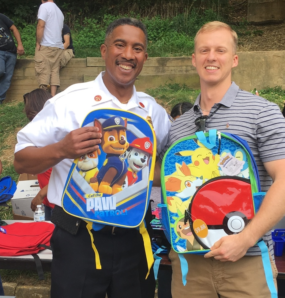 - Councilman Bailey with a supporter at his annual school supply give away.