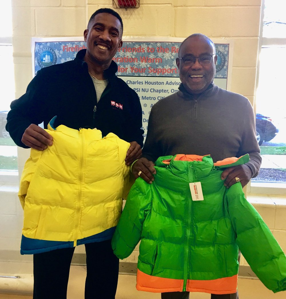 Councilman Bailey handing out new coats to Alexandria children with former Mayor Bill Euille.