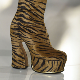 Tap your feet on the ground and sing with the cold wind...it's the winter season! Try some platform boots with some 90s inspired looks this winter to keep your feet high. The design comes in thrift range. Opt for some cheetah printed boots available in the stores to make the party girl inside you go wild. If you want, you can go for the patent leather models, which are pro in handling stomping through slushy streets.