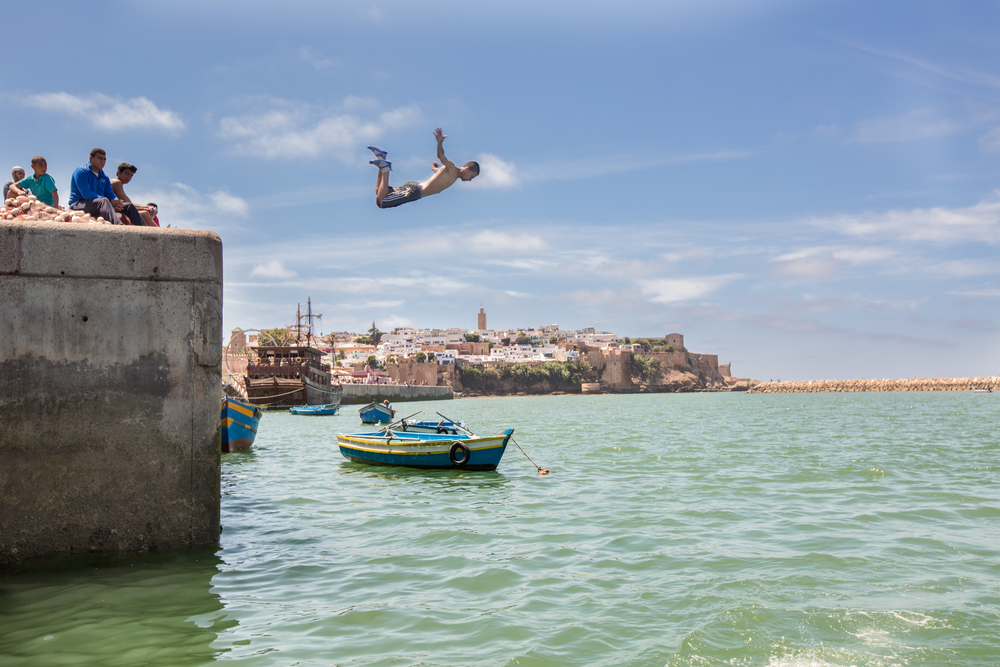 Kid diving over the historic city of Oudayas