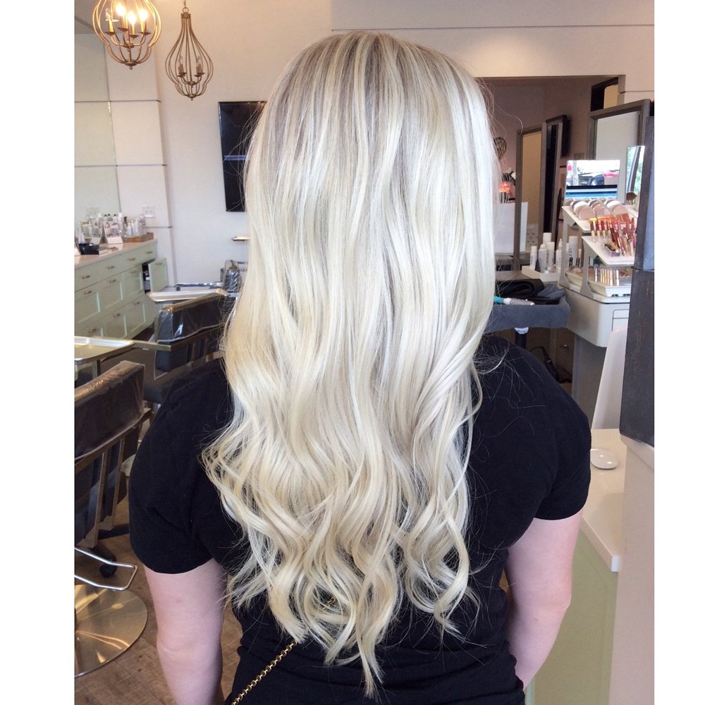 To achieve this pearl blonde color: ask for heavy highlights, and a toner with natural ash base.