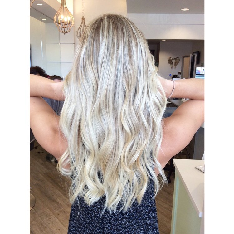 Slightly more ashy than the 1st color, for this type of result: ask for highlights with a ash toner.