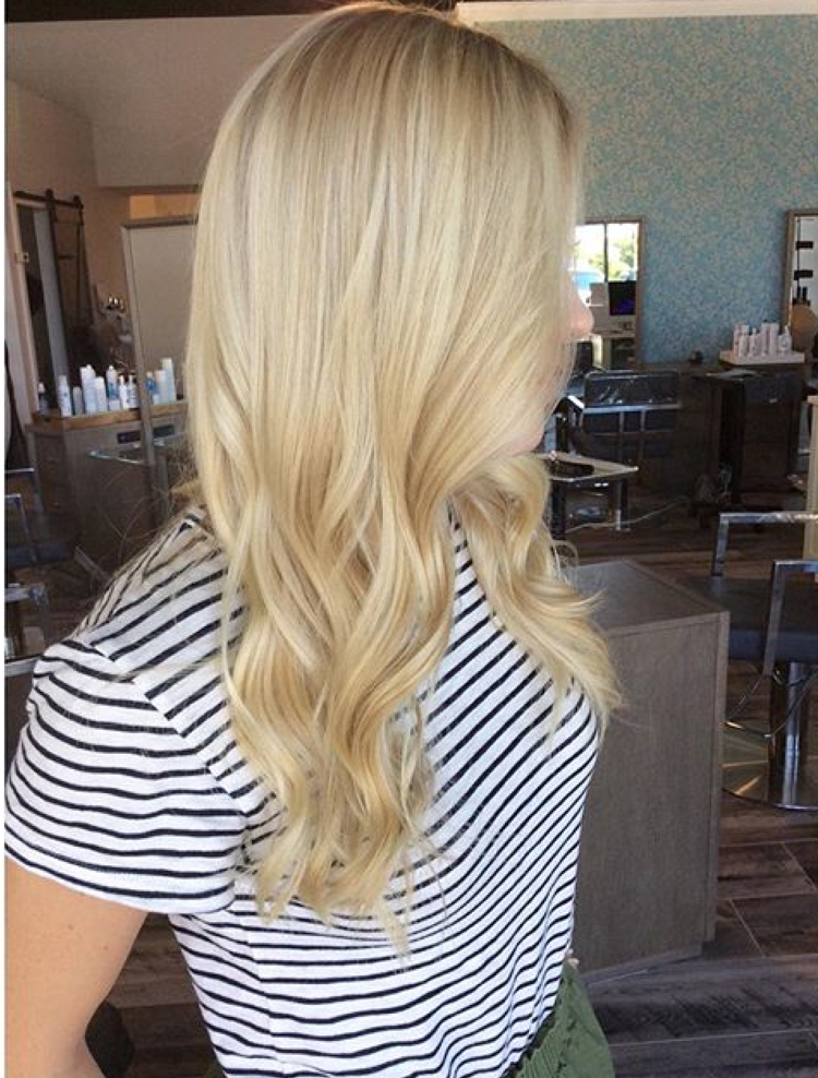A perfect example of a creamy buttery blonde. This color is right in the middle of warm and cool, yet still not super golden. For this color: I did highlights, bringing them to a level 10 but not white.Then glazed her with a level 10 natural blonde. I added a little ash to prevent the color from looking too brassy long term.
