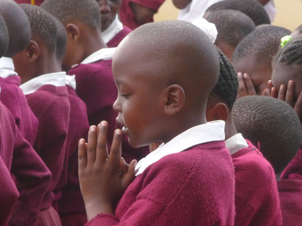 Students spend time in prayer at Mara Anglican Primary School in Tanzania.