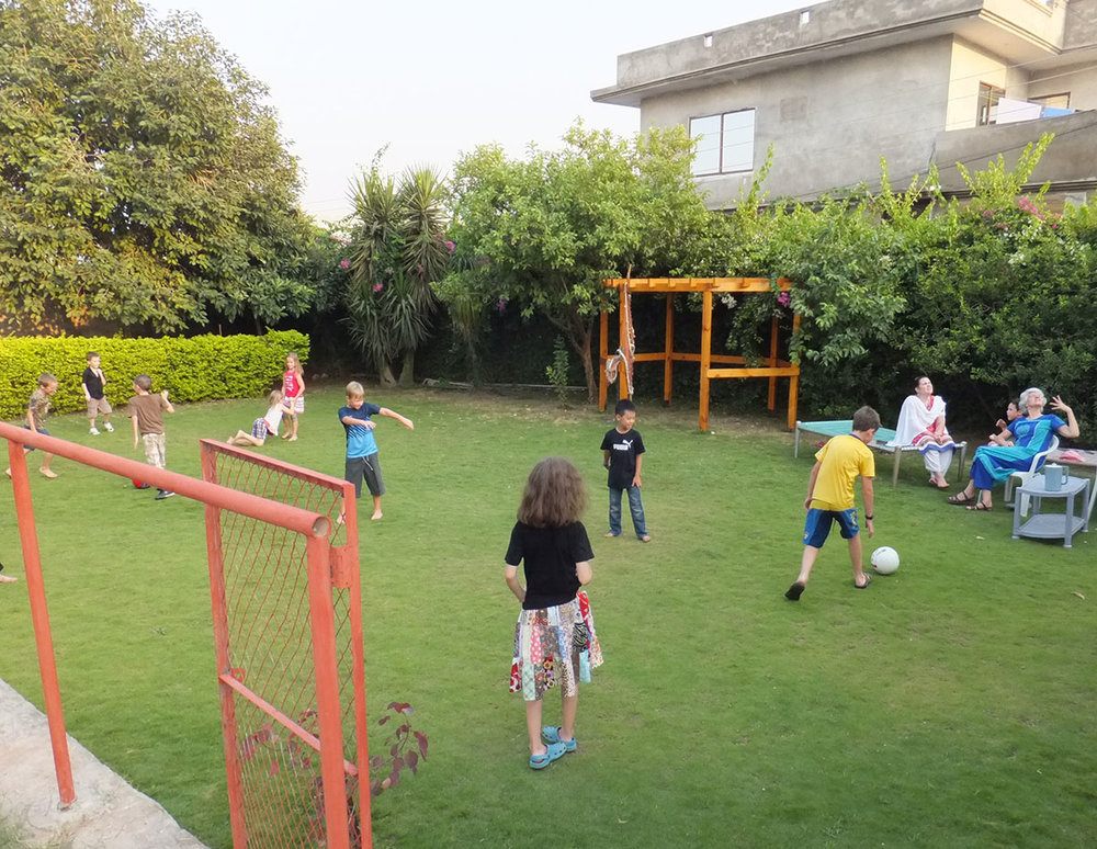 Children playing in the backyard at Aram.