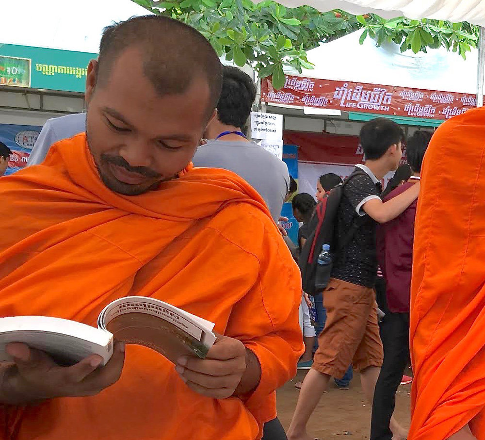 Monks at the Fount of Wisdom book stall.