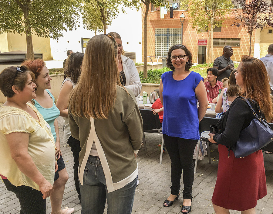 Jodi Lovell chatting with a group of women in Spain.