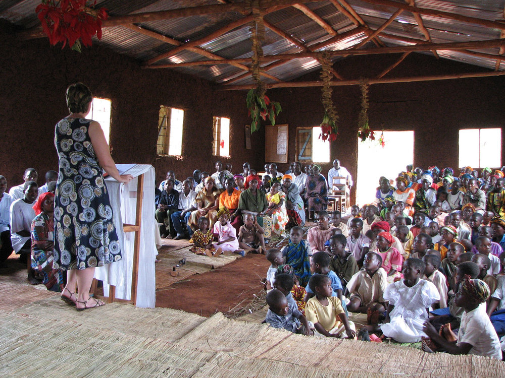 Liz Burns speaking at a church in Tanzania.