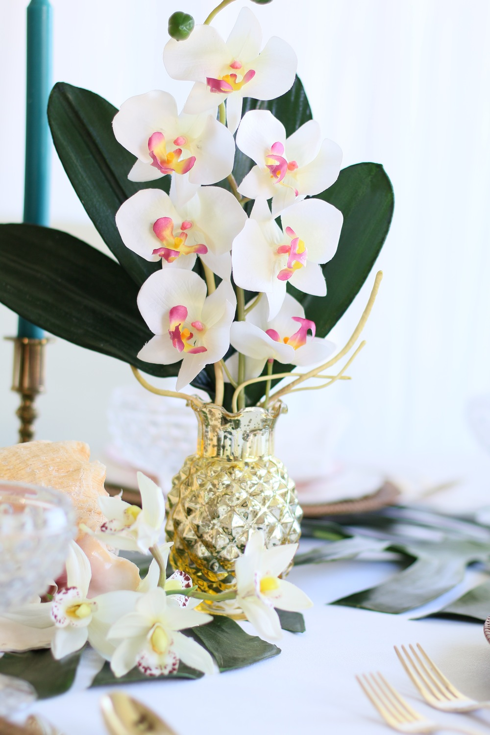 Palm leaves, tropical flowers, golden pineapples, wicker, seashells, & golden accents - Perfect for a baby shower, bridal shower, or birthday celebration! @inJOYtheParty