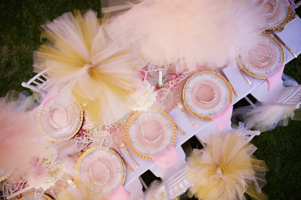 Copy of A rental collection with an elaborate ensemble of pink tutu centerpieces, white chiavari chairs, glittery runners, pink and white flowers, and sparkling tiaras that will dazzle even a Queen!