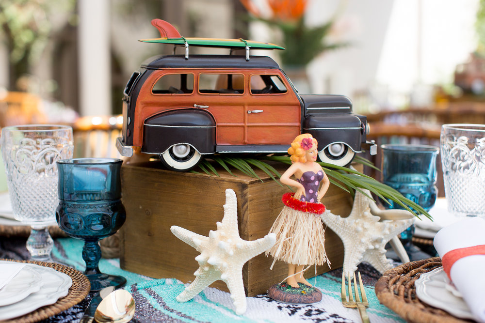A vintage surfer inspired rental collection! Hang loose with our vintage mini VW buses, pin up dashboard girls, touches of Tiki, palm leaves and tropical faux florals.