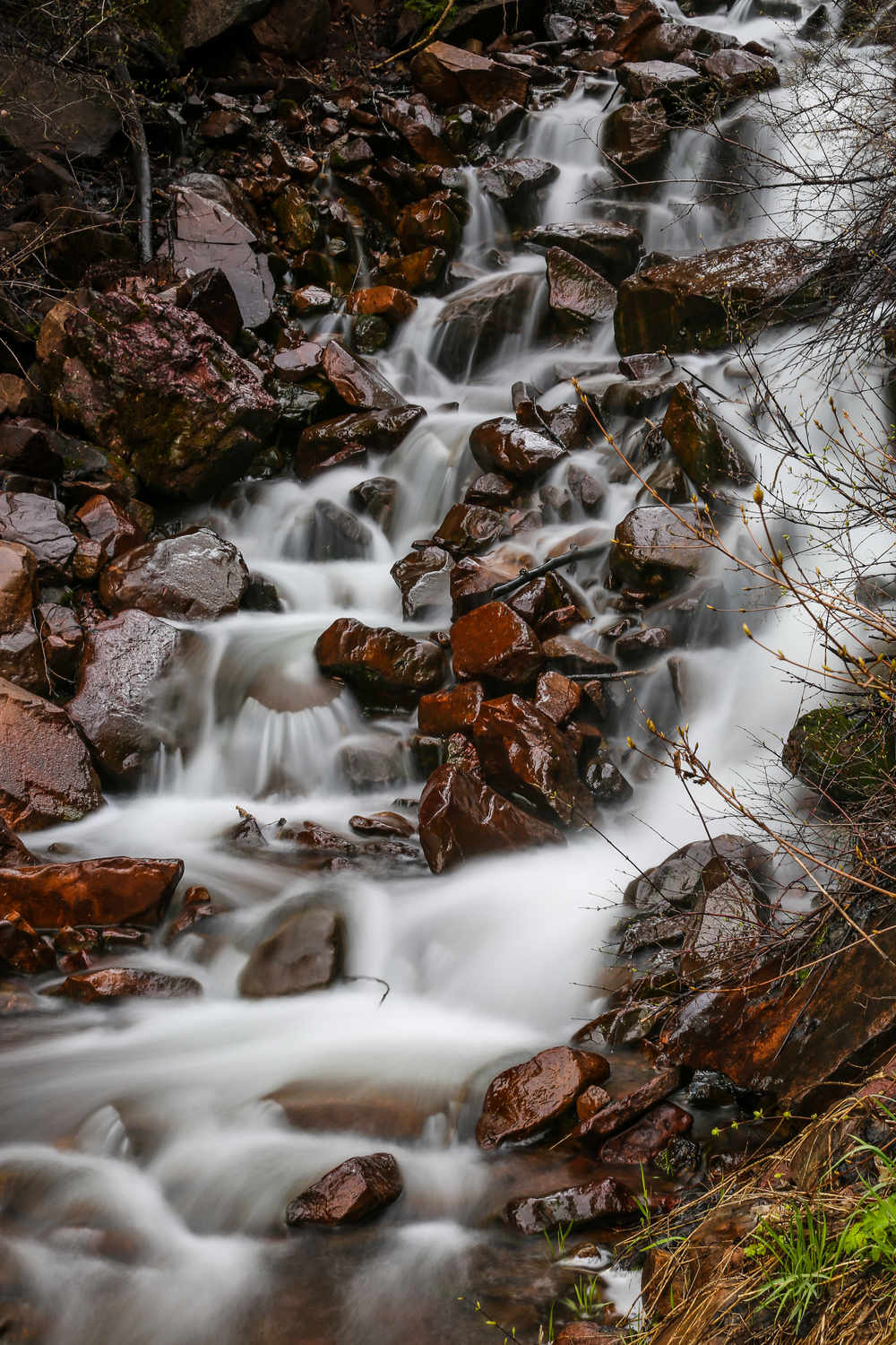 Falls in Park City, Utah. Shot with 50mm lens on a Canon 5D, with a neutral density filter and polarizer. ISO 100, f/13, Shutterspeed 2.0 secs.