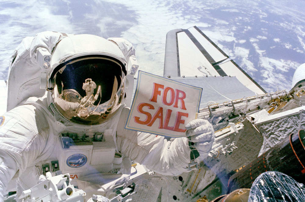 "In  this image recently featured by @NASA_Marshall , NASA astronaut Dale Gardner holds a ""For Sale"" sign after the retrieval of two malfunctioning satellites. In 1984, space shuttle Discovery launched to deploy a pair of communication satellites and to retrieve these malfunctioning ones."