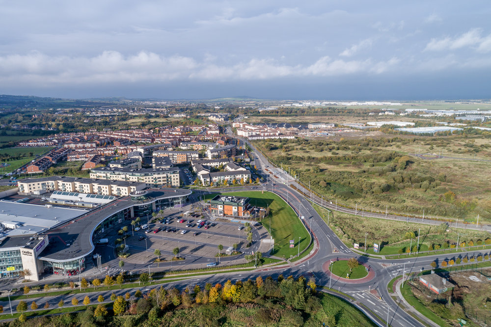 09. Shopping centre - Looking West including Cairn Site, road network, Luas line and housing estates.jpg