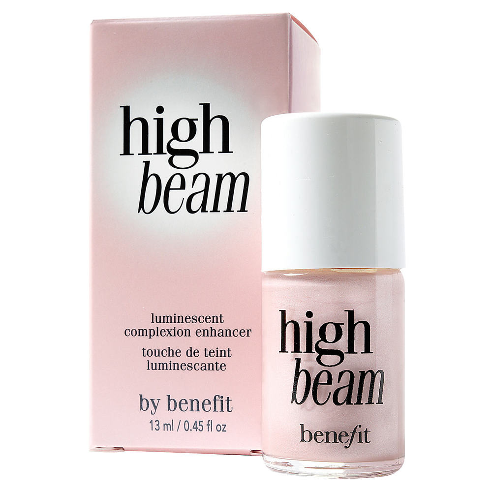 BENEFIT High Beam Complextion Enhancer   A satiny pink liquid highlighter that accents cheek and brow bones for a fresh faced dewy look. Use it as a spot highlighter over makeup, or under your foundation for an all over subtle and long lasting radiant glow. High Beam is versatile product that Illuminates, uplifts and highlights just where you want it. Why not spread a little on your collar bone and decalotage too for a little sexy shimmer.
