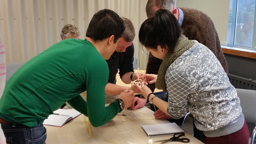 Teams work to complete the Marshmellow Challenge