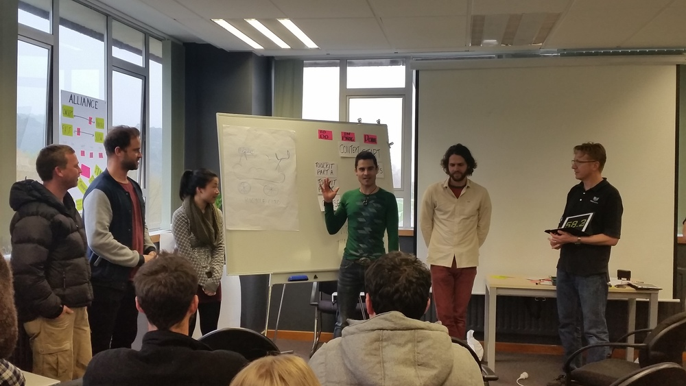 Teams pitch their 'businesses' in the Half-Baked Game