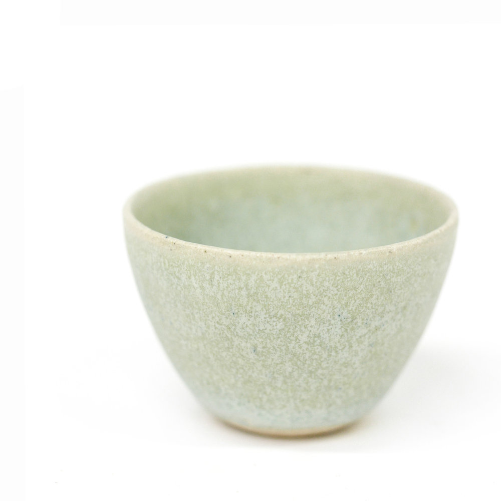 Thrown miniature bowl with a glaze developed to mimic seaglass