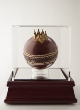 The Treachery  (Forbidden Fruits Series), 2015-, Hand carved leather cricket ball and 24c gold wire in custom made Perspex box