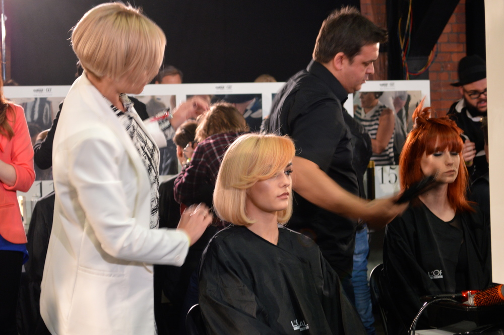 Tanya Styling Carly's hair at the L'Oreal Colour Trophy 2015 North Western Regional Final in Manchesters, Liverpool Warehouse.