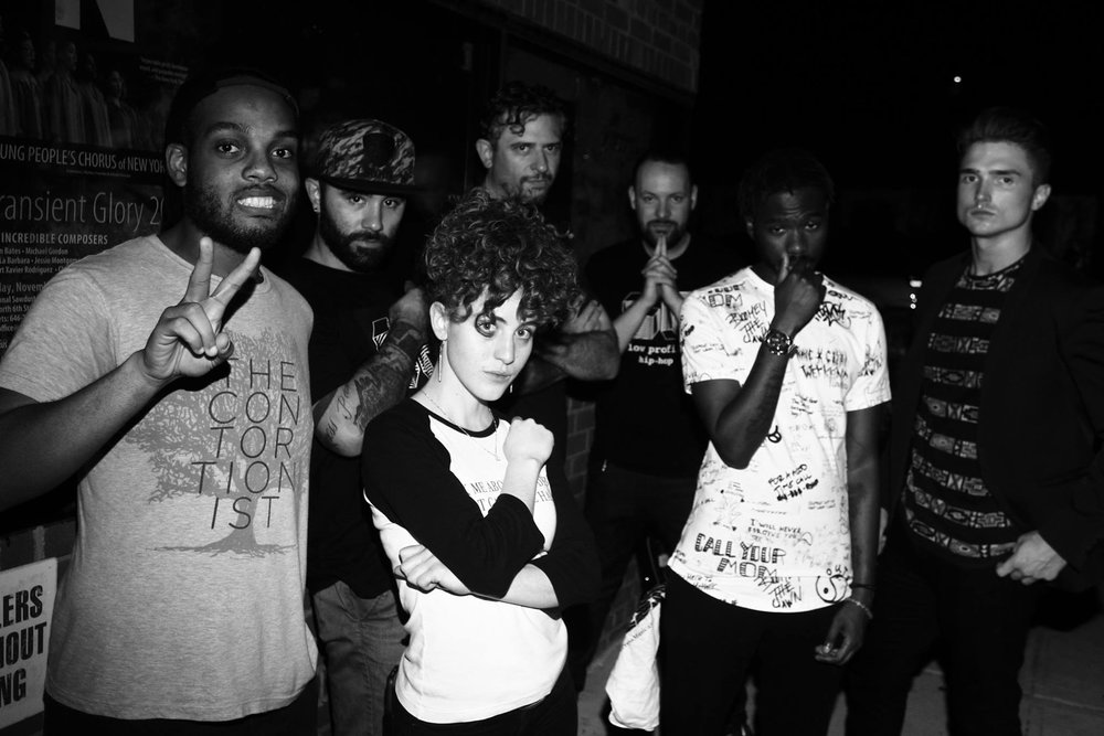 "From the left: Zee Daniels (guitar), Stevie Kings (drums), Lauren Renahan (vocals), Dan Victor (bass), Brandon ""B-Sauce"" Wentzel (B-Sauce), Deascent (rapper), and Brent Butler (rapper, vocals, guitar)"